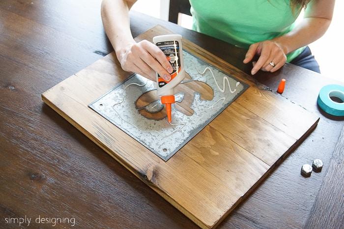 Glue DIY Industrial Ampersand Decor together
