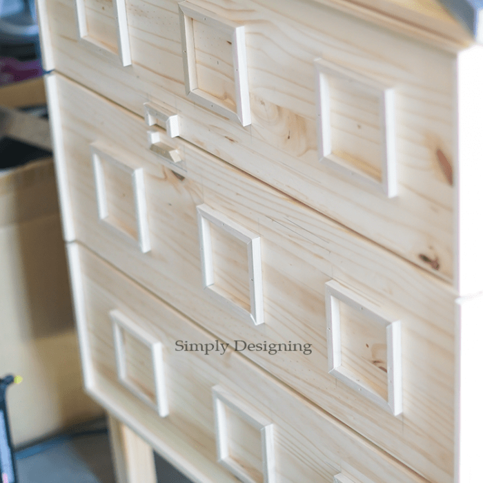 Add square moldings to the face of dresser
