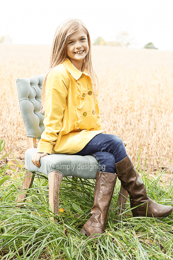 Photo of Girl on Chair in Field