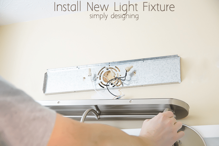how to install bathroom light install a new bathroom light fixture 23430