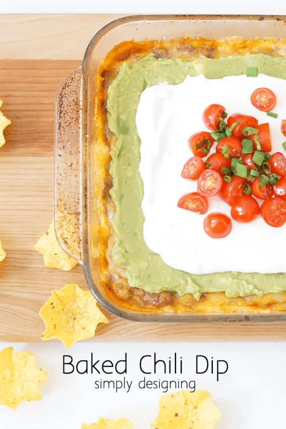 Baked Chili Dip - this is an amazing baked 7 layer dip! Perfect to bring to a party!