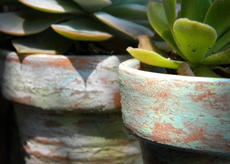 dirt painted clay pots